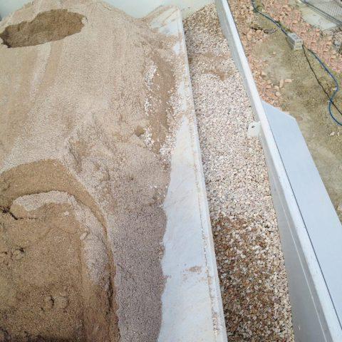 Paratia mobile regolabile compartimento sabbia